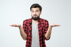 Free Confused Hispanic Man Giving I Dont Know Gesture On White Background. Stock Images - 174588254