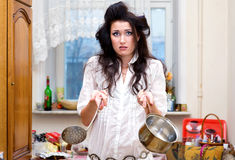 Confused housewife on the kitchen Royalty Free Stock Images