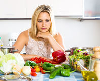 Confused housewife in the kitchen Stock Photos