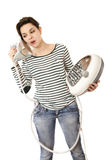 Confused ironing woman. Royalty Free Stock Images