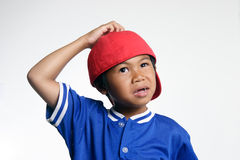 Confused Kid. In Red Baseball Cap Royalty Free Stock Images