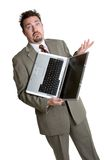 Confused Laptop Man. Young confused man holding laptop stock photo
