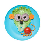 Confused lion made of vegetables on plate Stock Images