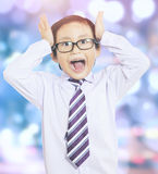 Confused little boy with bokeh background Royalty Free Stock Image