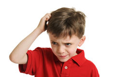 Confused little boy portrait. Portrait of a 6 year old boy confused and scratching his head isolated on white Stock Photos