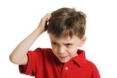Confused little boy portrait stock photos
