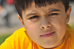 Confused Look. Little boy is confused and thoughtful. He wrinkles his nose and squints Stock Images