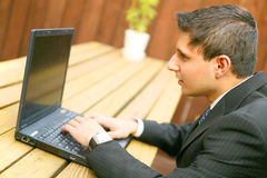 Confused Looking At Laptop Royalty Free Stock Image