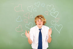 Confused by love. Cute young high school student is confused by love Stock Photos