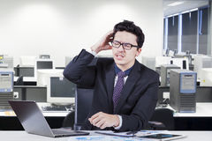Confused male accountant with paperwork Royalty Free Stock Photo