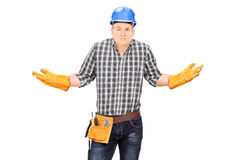 Confused male engineer gesturing with hands Stock Photography