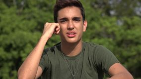 Confused Male Hispanic Teenage Soldier Recruit. A handsome hispanic male teen stock video footage