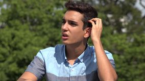 Confused Male Hispanic Teenager Having An Idea. A handsome hispanic male teen stock video