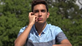Confused Male Hispanic Teenager Thinking. A handsome hispanic male teen stock footage