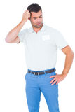 Confused male technician scratching head Royalty Free Stock Images