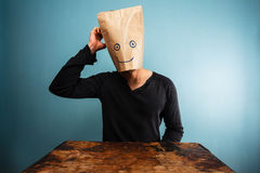 Confused man with bag over his head Royalty Free Stock Images