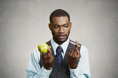 Confused man craving cigarette, making bad health choices royalty free stock photo