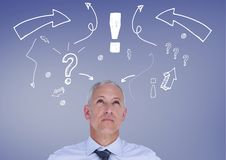 Confused man with exclamation mark, arrow sign and question mark against blue background Royalty Free Stock Image