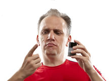 Confused man  the first time tries a man's against wrinkles cream Royalty Free Stock Photography