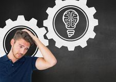 Confused man with gear icons on black background Stock Image