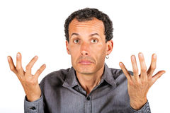 Confused man giving I don't know gesture Stock Images