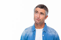 Confused man with grey hair thinking Royalty Free Stock Photography