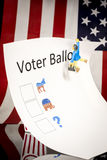 Confused man hangs from a voter ballot Stock Images