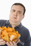 Confused Man Holding Bowl Of Nachos Stock Image
