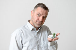 Confused Man Holding Crumpled Euro Notes Royalty Free Stock Photos