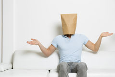 Confused  man with paper bag covering his head. Stock Photos
