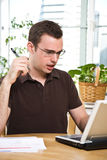 Confused man paying bills Stock Image