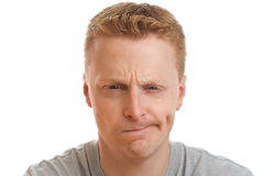 Confused man portrait. Portrait of a confused man isolated on pure white background stock photo