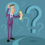 Confused man with question mark Stock Image