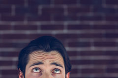 Confused man with raised eyebrows Royalty Free Stock Image