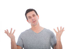 Confused man raising his upturned palms. And shrugging to show his ignorance, isolated on white Royalty Free Stock Images
