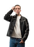 Confused Man Scratching Head. A confused young man is scratching his head, isolated against a white background Royalty Free Stock Image