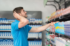 Confused Man Shopping At The Supermarket Stock Image
