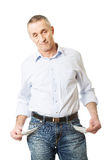 Confused man showing his empty pockets Royalty Free Stock Image