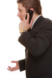 Confused man talking on mobile phone smartphone Stock Image