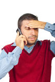 Confused man talking by phone mobile royalty free stock photography