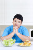 Confused man to choose meal Stock Photos