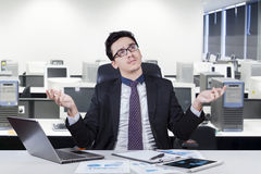 Confused man working at office Stock Photo