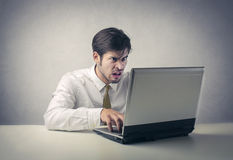 Confused man working at the pc Royalty Free Stock Photos