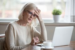 Confused Mature Woman Thinking About Online Problem Looking At L Royalty Free Stock Image