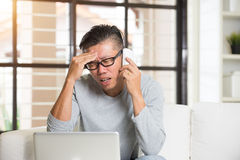 Confused matured asian male Royalty Free Stock Photography