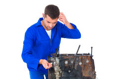 Confused mechanic repairing car engine Stock Images