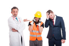 Confused medic or doctor near builder and businessman. With headache isolated on white background Royalty Free Stock Photos