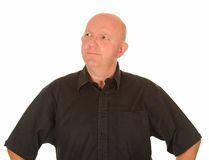 Confused middle aged man. Half body portrait of confused middle aged man with bald head Royalty Free Stock Images