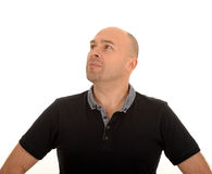 Confused middle aged man. Half body portrait of confused middle aged man with bald head stock images