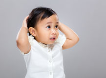 Confused mixed race baby Stock Image